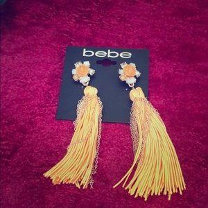BEBE orange and chain fringe earrings